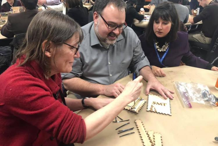 SMT members building a kalimba at a national conference